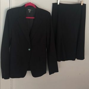 Black suit: jacket and flaired knee length skirt